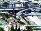 slow motion AERIAL over time lapse traffic on Long Beach highway + Century highway overpasses / California