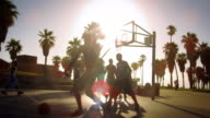 Slow motion basketball game with lens flare shot near Venice Beach, California