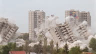 slow motion buildings imploding and collapsing / demolition