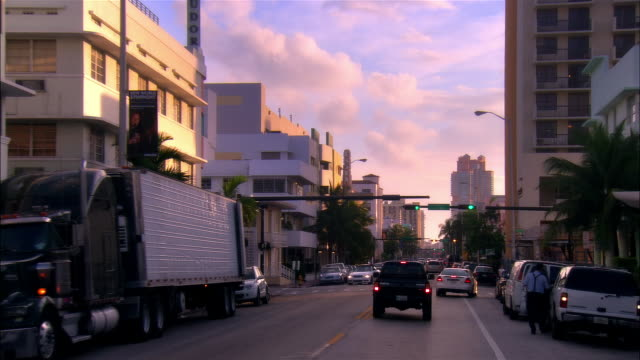Slow motion car point of view traffic and buildings on Collins Avenue/ Miami Beach, Florida