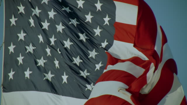 Slow motion close up American flag waving in breeze