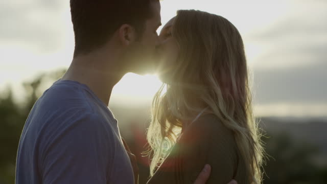Slow motion close up of couple kissing / Mona, Utah, United States