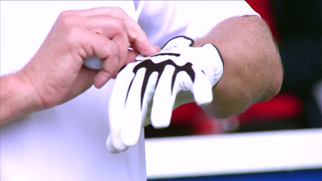 slow motion close up on hand and glove