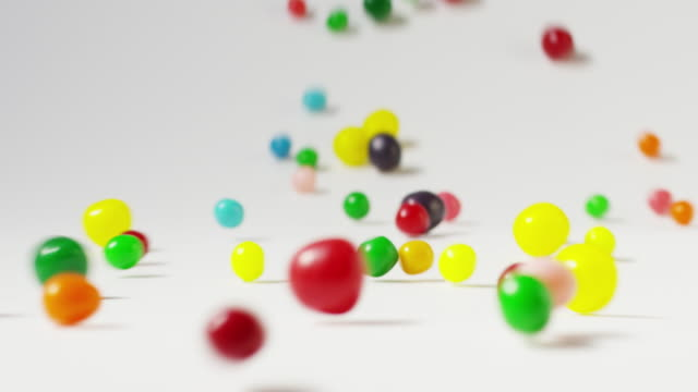 Slow motion close up shot of rolling jellybeans / Cedar Hills, Utah, United States