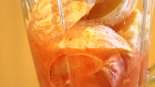 Slow motion: Close-up of blending fruits