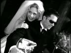 B/W slow motion FLASH FRAMES bridal couple sitting + talking on motorcycle on city sidewalk