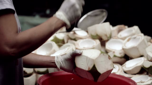 Slow Motion : Hands Chopping Coconut With A Knife