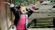Slow motion happy village boy cheering up