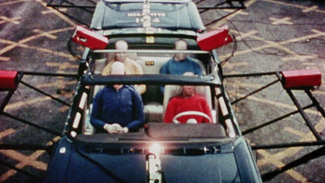 1968 slow motion high angle convertible car with test dummies is rear ended by another car during crash test