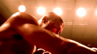Slow motion low angle two boxers punching in ring