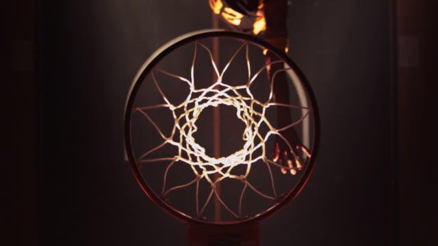 Slow motion HA CU Male Basketball Player slam dunking