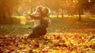 Slow motion: Mother and child in the park