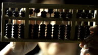 Slow Motion of Accountant Using Traditional Maths Tool Abacus