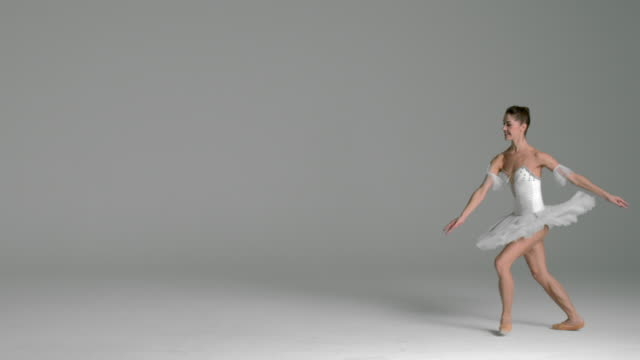 slow motion of ballerina performing grand jeté in studio