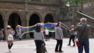 Slow motion of bubble playing in Central Park, New York City