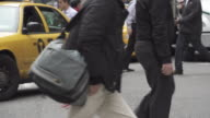 Slow motion of Crowds of People Walking Crossing Street in New York City