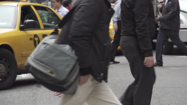 Slow motion of Crowds of People Walking Crossing Street in New York City