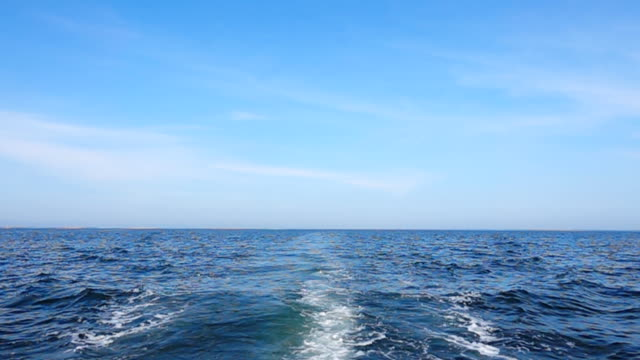 Slow motion of Cruise ship track with calm sea and clear sky