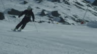 Slow motion of downhill skier.