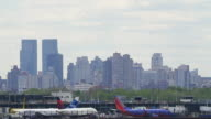 Slow motion of passenger planes at Laguardia airport runway in New York City