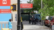 Slow motion of patient arrives at hospital emegency in New York City