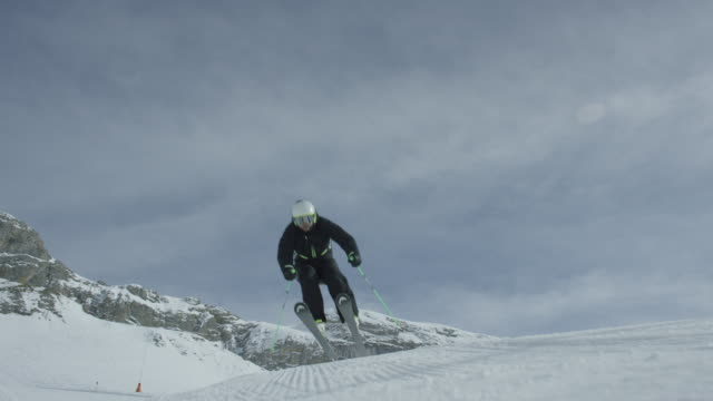 Slow motion of skier jumping.