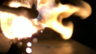 Slow motion of torch lighting with striker