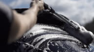 Slow motion of washing cleaning car rear window