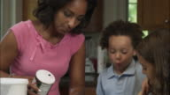Slow motion pan of mother measuring salt.