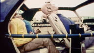 1968 slow motion MS PROFILE crash test dummies being jerked back + forth in car during crash test