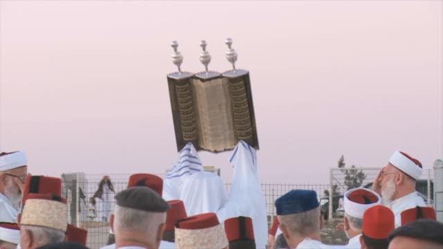Slow Motion, Samaritans celebrate Sukkot with holy Book,at Mount Gerizim near West Bank city of Nablus,Samaria