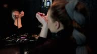 Slow motion shot of a beautiful young woman applying parfume