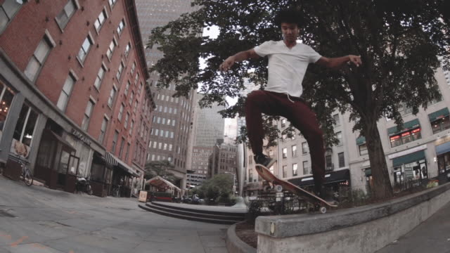 Slow Motion shot of a teenager skateboarding in the streets of New York City