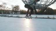 A slow motion shot of a young man skateboarding at iconic Flushing Meadows, Queens