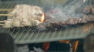 Slow motion shot of BBQ. Yakitori,Yakiniku