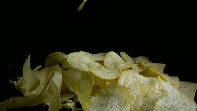 Slow Motion shot of falling Potato Chips