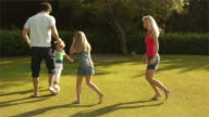 Slow motion shot of family playing soccer/Sotogrande,Spain