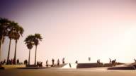 Slow motion shot of jumping skateboarder at Ocean Front Walk near Venice Beach, California
