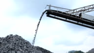 Slow motion shot of quarry mine industry rock extraction heavy machinery equipment
