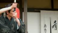 CU,Slow motion shot of Samurai with katana.