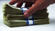 Slow Motion Shot of Stacks of Dollar Bills Falling