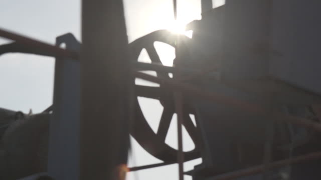 Slow motion shot of the mechanism of a pumpjack turning at an oil field near Baku.