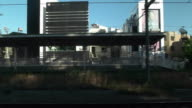 Slow motion. Side point of view. Shot of passenger train scenery. Tokyo, Japan