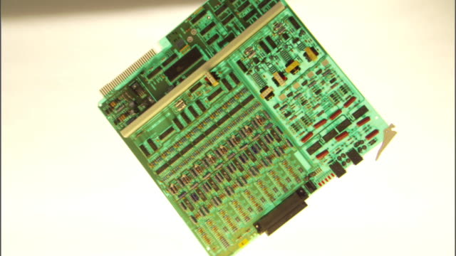 Slow motion snap zoom in and out of a green circuit board.