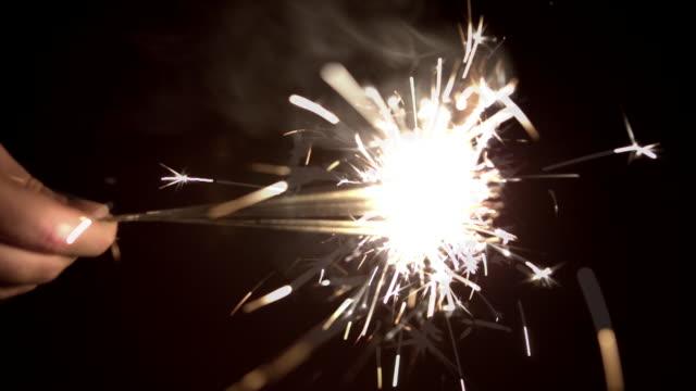 Slow motion sparklers Human hand swining