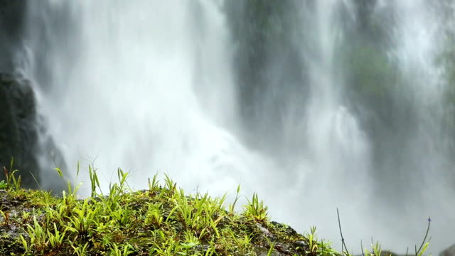 Slow Motion telephoto Waterfall with grassy mound