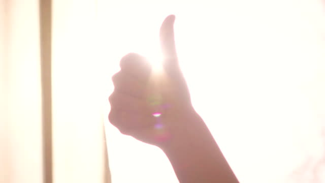 Slow motion: thumb up success symbol