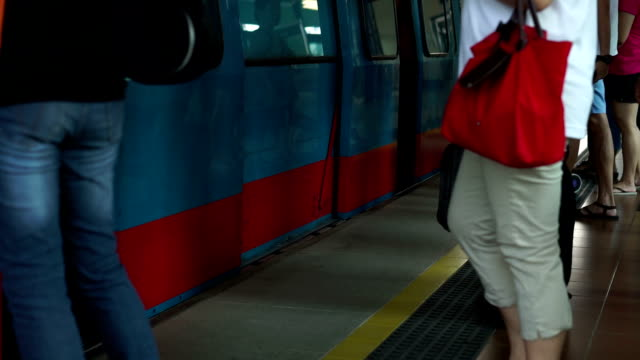 Slow Motion Train door opens when Commuters enters and leaves