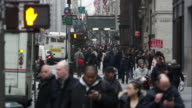 Slow motion view of a busy street with people and vehicles in downtown Manhattan.