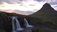 Slow motion wide establishing shot of Kirkjufellsfoss waterfall, Iceland